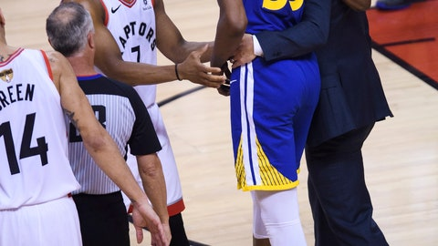 <p>               Golden State Warriors forward Kevin Durant (35) leaves after being injured as Toronto Raptors guard Kyle Lowry (7) talks to him during first-half basketball action in Game 5 of the NBA Finals in Toronto, Monday, June 10, 2019. (Nathan Denette/The Canadian Press via AP)             </p>