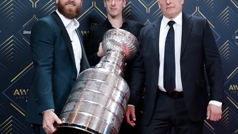 <p>               From left, Ryan O'Reilly, Jordan Binnington and Craig Berube of the St. Louis Blues pose with the Stanley Cup on the red carpet before the NHL Awards, Wednesday, June 19, 2019, in Las Vegas. (AP Photo/John Locher)             </p>