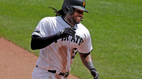 <p>               This May 23, 2019, file photo shows Pittsburgh Pirates' Josh Bell rounding third after hitting a solo home run off Colorado Rockies relief pitcher Carlos Estevez during the seventh inning of a baseball game in Pittsburgh.The first baseman is hitting home runs at a historic rate for the 138-year-old franchise thanks to an approach that's centered on consistency and not constant tinkering. (AP Photo/Gene J. Puskar/File)             </p>