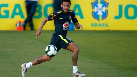 <p>               Brazil's soccer player Neymar runs for the ball during a practice session at the Granja Comary training center ahead of the Copa America tournament, in Teresopolis, Brazil, Tuesday, May 28, 2019. (AP Photo/Leo Correa)             </p>