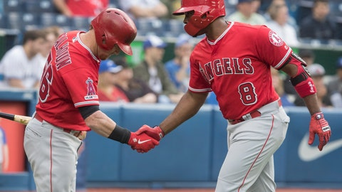 <p>               Los Angeles Angels' Justin Upton (8) is greeted by teammate Kole Calhoun after hitting a home run against the Toronto Blue Jays during second-inning baseball game action in Toronto, Monday, June 17, 2019. (Fred Thornhill/The Canadian Press via AP)             </p>