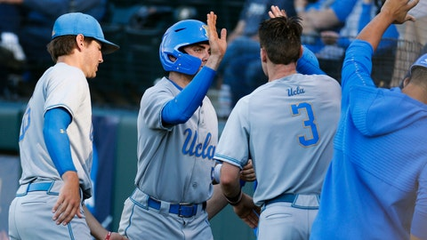 <p>               UCLA's Garrett Mitchell, second from left, celebrates with teammates after he scored against Michigan during the first inning of an NCAA college baseball tournament super regional game in Los Angeles, Saturday, June 8, 2019. (AP Photo/Ringo H.W. Chiu)             </p>