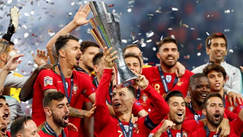 <p>               Portugal players celebrate with their trophy after defeating the Netherlands 1-0 in the UEFA Nations League final soccer match at the Dragao stadium in Porto, Portugal, Sunday, June 9, 2019. (AP Photo/Armando Franca)             </p>