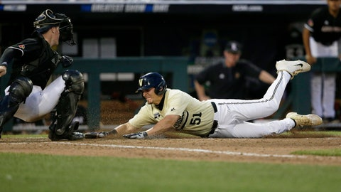 <p>               Vanderbilt's JJ Bleday (51) scores against Louisville catcher Henry Davis on a double by Ethan Paul during the ninth inning of an NCAA College World Series baseball game in Omaha, Neb., Friday, June 21, 2019. (AP Photo/Nati Harnik)             </p>