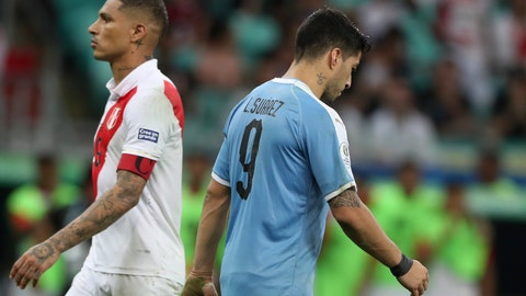 <p>               Uruguay's Luis Suarez, right, walks by Peru's Paolo Guerrero, left, after failing to score during the penalty shoot-out during a Copa America quarterfinal soccer match at the Arena Fonte Nova in Salvador, Brazil, Saturday, June 29, 2019. (AP Photo/Ricardo Mazalan)             </p>