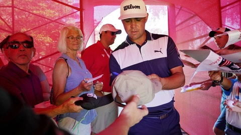 <p>               Gary Woodland signs autographs after competing in the Pro-Am for the Rocket Mortgage Classic golf tournament, Wednesday, June 26, 2019, in Detroit. (Mike Mulholland/Ann Arbor News via AP)             </p>