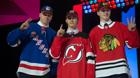 <p>               Top draft picks New York Rangers' Kaapo Kakko, New Jersey Devils' Jack Hughes and Chicago Blackhawks' Kirby Dach pose during the first round of the NHL hockey draft Friday, June 21, 2019, in Vancouver, British Columbia. (Jonathan Hayward/The Canadian Press via AP)             </p>