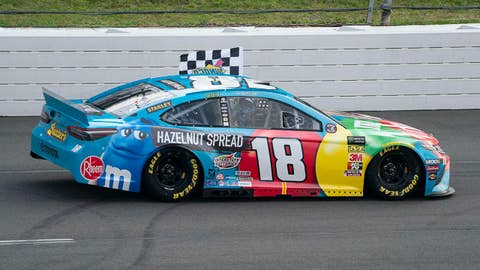 LONG POND, PA - JUNE 02: Monster Energy NASCAR Cup Series driver Kyle Busch of the #18 Joe Gibbs Racing Toyota Camry drives with the checkered flag after winning the Monster Energy Pocono 400 on June 1, 2019 at Pocono Raceway in Long Pond, PA. (Photo by Gregory Fisher/Icon Sportswire via Getty Images)