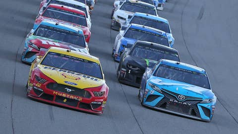 BROOKLYN, MICHIGAN - JUNE 10: Joey Logano, driver of the #22 Shell Pennzoil Ford, and Martin Truex Jr., driver of the #19 Auto-Owners Insurance Toyota, lead the field to a restart during the Monster Energy NASCAR Cup Series FireKeepers Casino 400 at Michigan International Speedway on June 10, 2019 in Brooklyn, Michigan. (Photo by Matt Sullivan/Getty Images)