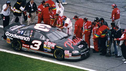 DAYTONA BEACH, FL - FEBRUARY 15, 1998:  Crew members along pit road congratulate Dale Earnhardt following his victory in the Daytona 500 at Daytona International Speedway. (Photo by ISC Images & Archives via Getty Images)