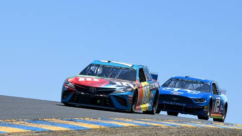 SONOMA, CALIFORNIA - JUNE 23: Kyle Busch, driver of the #18 M&M's Hazelnut Toyota, leads Ryan Blaney, driver of the #12 PPG Ford, during the Monster Energy NASCAR Cup Series Toyota/Save Mart 350 at Sonoma Raceway on June 23, 2019 in Sonoma, California. (Photo by Robert Reiners/Getty Images)