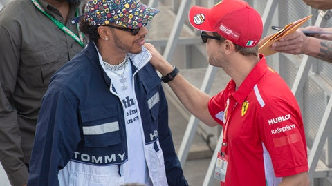 <p>               Mercedes driver Lewis Hamilton, left, of Great Britain, chats with Ferrari driver Sebastian Vettel, of Germany, during the autograph session at the open house day for the Canadian Grand Prix auto race in Montreal, Thursday, June 6, 2019. (Ryan Remiorz/The Canadian Press via AP)             </p>