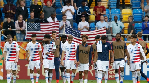 <p>               United States players walk on the pitch after their team's 1-2 loss during the quarter final match between USA and Ecuador at the U20 World Cup soccer in Gdynia, Poland, Saturday, June 8, 2019. (AP Photo/Darko Vojinovic)             </p>