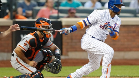 <p>               New York Mets' Robinson Cano, back in the lineup after a stint on the injured list, watches his groundout with the bases loaded during the third inning of the team's baseball game against the San Francisco Giants, Wednesday, June 5, 2019, in New York. Giants catcher Aramis Garcia is at left. (AP Photo/Kathy Willens)             </p>