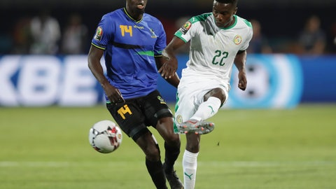 <p>               Senegal's Moussa Wague, right, passes the ball by Tanzania's Jhon Raphael Bocco during the African Cup of Nations group C soccer match between Senegal and Tanzania at 30 June Stadium in Cairo, Egypt, Sunday, June 23, 2019. (AP Photo/Hassan Ammar)             </p>