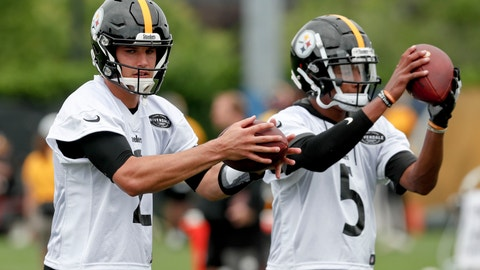 <p>               Pittsburgh Steelers quarterbacks Mason Rudolph, left, and Joshua Dobbs, right, drop back to pass during an NFL football practice, Thursday, May 30, 2019, in Pittsburgh. (AP Photo/Keith Srakocic)             </p>
