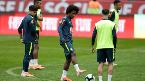 <p>               Brazil's Willian, center, attends a practice session of the national soccer team in Porto Alegre, Brazil, Saturday, June 8, 2019. Tite picked Willian on Friday to replace the injured Neymar for the Copa America. (AP Photo/Edison Vara)             </p>