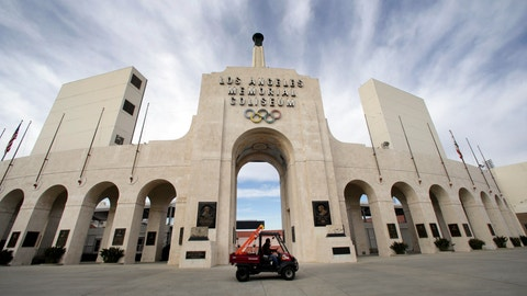 <p>               FILE - This Jan. 13, 2016 file photo shows the peristyle of the Los Angeles Memorial Coliseum in Los Angeles. United Airlines and the University of Southern California have reached a new naming rights agreement for Los Angeles Memorial Coliseum to resolve criticism that putting a corporate name on the stadium disrespects its role as a World War I monument. (AP Photo/Nick Ut, File)             </p>