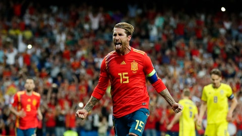 <p>               Spain's Sergio Ramos celebrates after scoring the opening goal with a penalty during the Euro 2020 Group F qualifying soccer match between Spain and Sweden at the Santiago Bernabeu stadium in Madrid, Monday June 10, 2019. (AP Photo/Manu Fernandez)             </p>