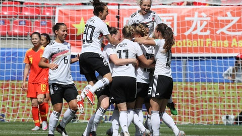 <p>               Germany's Giulia Gwinn is cheered by teammates after scoring her side's first goal during the Women's World Cup Group B soccer match between Germany and China, at the Roazhon Park stadium, in Rennes, France, Saturday, June 8, 2019. (AP Photo/David Vincent)             </p>