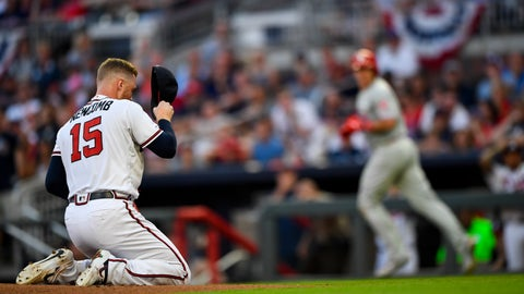 <p>               Atlanta Braves pitcher Sean Newcomb (15) goes to his knees after being hit in the head with a line drive by Philadelphia Phillies' J.T. Realmuto, right, as Realmuto makes his way to base on a ground-rule double and injury delay during the third inning of a baseball game Saturday, June 15, 2019, in Atlanta. Newcombe came out of the game. (AP Photo/John Amis)             </p>