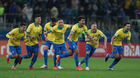 <p>               Brazil's soccer players celebrate winning at the end of the Copa America quarterfinal soccer match against Paraguay at the Arena do Gremio in Porto Alegre, Brazil, Thursday, June 27, 2019. (AP Photo/Natacha Pisarenko)             </p>