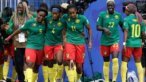 <p>               Cameroon players celebrate after scoring the opening goal during the Women's World Cup Group E soccer match between Cameroon and New Zealand at the Stade de la Mosson in Montpellier, France, Thursday, June 20, 2019. (AP Photo/Claude Paris)             </p>