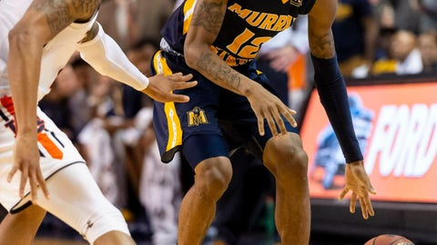 <p>               FILE - In this Dec. 22, 2018, file photo, Murray State guard Ja Morant (12) works around Auburn guard Bryce Brown (2) during the first half of an NCAA college basketball game, in Auburn, Ala. Morant, Darius Garland and Coby White make up a clear top tier of point guards in next week's NBA draft.  (AP Photo/Vasha Hunt, File)             </p>