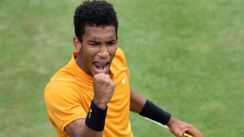 <p>               Felix Auger-Aliassime, of Canada, reacts during the quarterfinals of the Stuttgart Open tennis tournament against Dustin Brown of Germany,, Friday, June 14, 2019, in Stuttgart, Germany. Auger-Aliassime won 7-6 (3), 6-7 (2), 7-6 (2). (Silas Stein/dpa via AP)             </p>