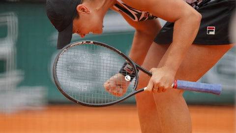 <p>               Australia's Ashleigh Barty celebrates winning her semifinal match of the French Open tennis tournament against Amanda Anisimova of the U.S. in three sets 7-6 (7-4), 6-3, 6-3, at the Roland Garros stadium in Paris, Friday, June 7, 2019. (AP Photo/Michel Euler)             </p>