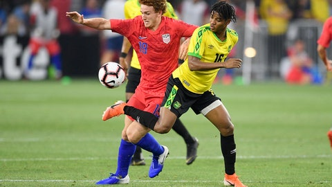 <p>               U.S. forward Josh Sargent (19) battles for the ball against Jamaica midfielder Peter Vassell (16) during the second half of an international friendly soccer match Wednesday, June 5, 2019, in Washington. Jamaica won 1-0. (AP Photo/Nick Wass)             </p>