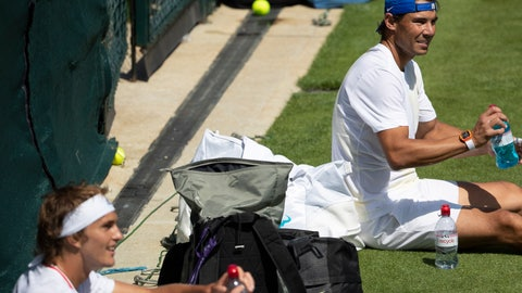 <p>               Rafael Nadal of Spain, right, and Alexander Zverev of Germany take a break during a training session at the All England Lawn Tennis Championships in Wimbledon, London, Thursday, June 27, 2019. The Wimbledon Tennis Championships 2019 will be held in London from 1 July to 14 July. (Peter Klaunzer/Keystone via AP)             </p>