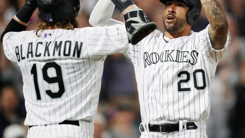 <p>               Colorado Rockies' Charlie Blackmon, left, congratulates Ian Desmond on his grand slam off San Diego Padres relief pitcher Robbie Erlin during the fifth inning of a baseball game Saturday, June 15, 2019, in Denver. (AP Photo/David Zalubowski)             </p>