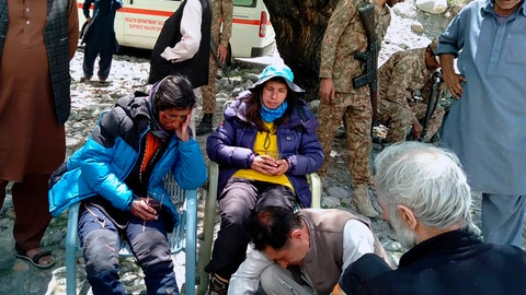 <p>               In this photo provided by Gilgit Baltistan regional police department, mountaineers receive initial treatment following their rescue, at a helipad in the town of Imit, Ghizer district of Gilgit Balistan region, Pakistan, Tuesday, Jun 18, 2019. A Pakistani army helicopter rescued on Tuesday four Italian and two Pakistani climbers stranded at an altitude of around 5,300 meters (17,390 feet) in the country's north, after an avalanche struck the team the previous day, a mountaineering worker said. A Pakistani member of the team was killed. (Gilgit Baltistan regional police department via AP)             </p>