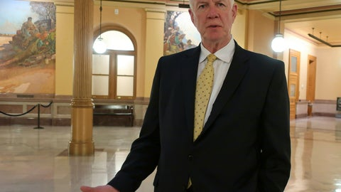 "<p>               Dave Lindstrom, a Republican candidate for the U.S. Senate in Kansas, discusses his campaign during an Associated Press interview, Wednesday, June 26, 2019, inside the Kansas Statehouse rotunda in Topeka, Kan. Lindstrom, a former Kansas City Chiefs player, says he is running partly because he's worried about what he sees as a growing embrace of socialism and, ""I think our country's under attack."" (AP Photo/John Hanna)             </p>"