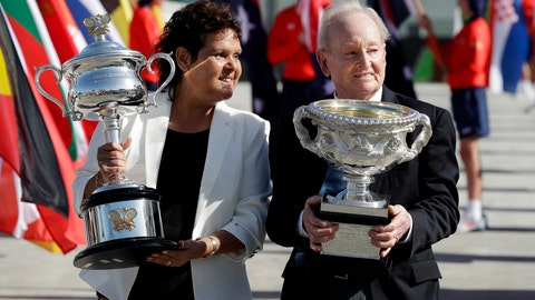 """<p>               FILE - In this Jan. 14, 2019, file photo, Australian tennis legends Evonne Goolagong Cawley and Rod Laver hold the women's and men's trophies, the Daphne Akhurst Memorial Cup and the Norman Brookes Challenge Cup at the official start of the Australian Open tennis championships in Melbourne, Australia. Goolagong Cawley says fellow indigenous athlete Ashleigh Barty's first Grand Slam singles title at the French Open was """"a joy to watch."""" (AP Photo/Aaron Favila, File)             </p>"""
