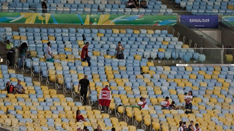 <p>               Fans sit on almost empty stands prior to a Copa America Group A soccer match between Bolivia and Peru at the Maracana stadium in Rio de Janeiro, Brazil, Tuesday, June 18, 2019. (AP Photo/Leo Correa)             </p>