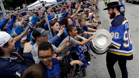 <p>               St. Louis Blues center Ryan O'Reilly carries the Stanley Cup during the Blues' NHL hockey Stanley Cup victory celebration in St. Louis on Saturday, June 15, 2019. (AP Photo/Darron Cummings)             </p>