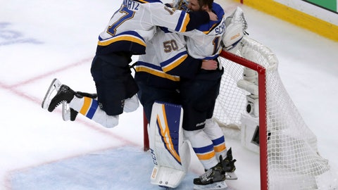 <p>               St. Louis Blues' Jaden Schwartz, left, and Brayden Schenn, right, mob goaltender Jordan Binnington, to celebrate their win over the Boston Bruins in Game 7 of the NHL hockey Stanley Cup Final, Wednesday, June 12, 2019, in Boston. (AP Photo/Charles Krupa)             </p>