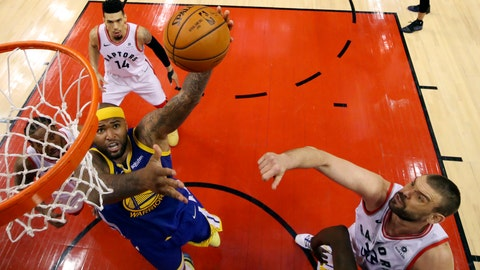 <p>               Golden State Warriors' DeMarcus Cousins (0) drives against Toronto Raptors' Marc Gasol (33), Danny Green (14) and Kawhi Leonard, left, during Game 2 of basketball's NBA Finals, Sunday, June 2, 2019, in Toronto. (Kyle Terada/The Canadian Press via AP, Pool)             </p>