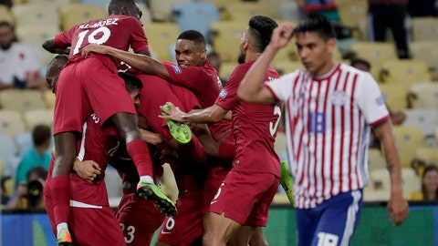 <p>               Qatar players celebrate their side's second goal against Paraguay, scored by Boualem Khoukhi, during a Copa America Group B soccer match at the Maracana stadium in Rio de Janeiro, Brazil, Sunday, June 16, 2019. (AP Photo/Silvia Izquierdo)             </p>