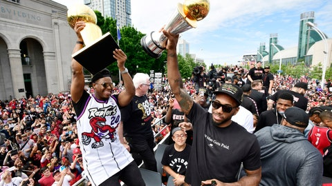 <p>               Toronto Raptors guard Kyle Lowry, left, holds the Larry O'Brien Championship Trophy as forward Kawhi Leonard holds his playoffs MVP trophy  during the NBA basketball championship team's victory parade in Toronto, Monday, June 17, 2019. (Frank Gunn/The Canadian Press via AP)             </p>