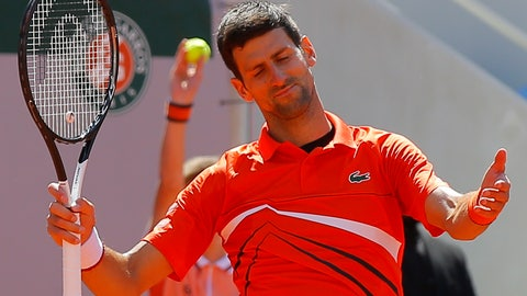 <p>               Serbia's Novak Djokovic reacts after missing a shot against Austria's Dominic Thiem in their semifinal match of the French Open tennis tournament at the Roland Garros stadium in Paris, Saturday, June 8, 2019. (AP Photo/Michel Euler)             </p>