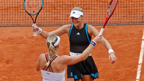 <p>               Hungary's Timea Babos, left, and France's Kristina Mladenovic, right, celebrate winning the women's doubles final match of the French Open tennis tournament against China's Duan Yingying and Zheng Saisai at the Roland Garros stadium in Paris, Sunday, June 9, 2019. (AP Photo/Michel Euler)             </p>