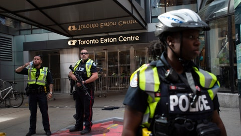 <p>               Toronto Police secure the scene where shots were fired during the Toronto Raptors NBA basketball championship parade in Toronto, Monday, June 17, 2019. (Andrew Lahodynskyj/The Canadian Press via AP)             </p>