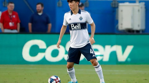 <p>               Vancouver Whitecaps' Inbeom Hwang controls the ball in the first half of the team's MLS soccer match against FC Dallas in Frisco, Texas, Wednesday, June 26, 2019. (AP Photo/Tony Gutierrez)             </p>