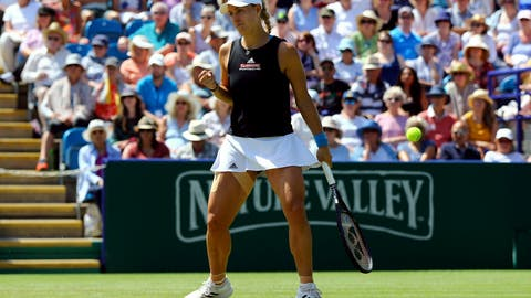 <p>               Angelique Kerber of Germany celebrates after defeating Simona Halep of Romania at the quarter-finals of the Nature Valley International tennis tournament, at Devonshire Park, Eastbourne, Thursday, June 27, 2019. Kerber won 6-4, 6-3. (Gareth Fuller/PA via AP)             </p>