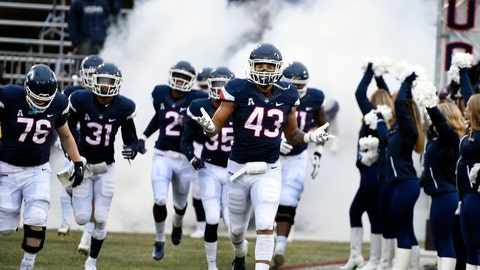 <p>               FILE - In this Nov. 24, 2018, file photo, Connecticut linebacker Darrian Beavers (43) leads his team onto the field before the start of an NCAA college football game against Temple in East Hartford, Conn. UConn football is on the road to independence and the American Athletic Conference is not feeling any pressure to replace the Huskies when they leave for the Big East. The University of Connecticut is set to announce later this week that it will be leaving the AAC and re-joining the Big East, which does not sponsor football, in 2020. (AP Photo/Stephen Dunn, File)             </p>