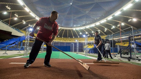 <p>               FILE - In this April 1, 2017, file photo, ground crew works on the bullpen behind the outfield wall at Olympic Stadium in Montreal. Starved for fans despite success on the field, the Tampa Bay Rays have been given the go-ahead by Major League Baseball to look into playing a split season in Montreal. No timetable for the possible plan was announced. An idea under consideration is for the Rays to play early in the season in Tampa Bay and later in Montreal. (Paul Chiasson/The Canadian Press via AP, File)             </p>