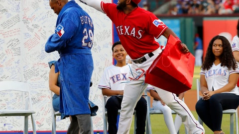 <p>               Retired Texas Rangers player Adrian Beltre tries on a gift presented to him by the team as shortstop Elvis Andrus reaches for his head during a jersey retirement ceremony for Beltre before the second baseball game of a doubleheader against the Oakland Athletics in Arlington, Texas, Saturday, June 8, 2019. (AP Photo/Tony Gutierrez)             </p>